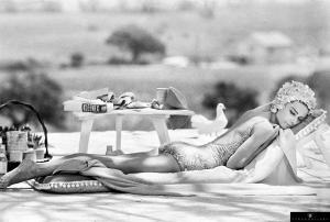 Actress Audrey Hepburn relaxing by a pool during filming for Stanley Donen's 1967 'Two for the Road' in St Tropez.