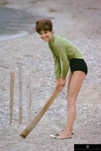 Audrey Hepburn plays cricket on the beach during a break from filming Stanley Donen's 1967 'Two for the Road' in 1966.