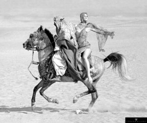Fashion model Connie Barr photographed on the back of a horse in Egypt for Queen magazine, February 1963.