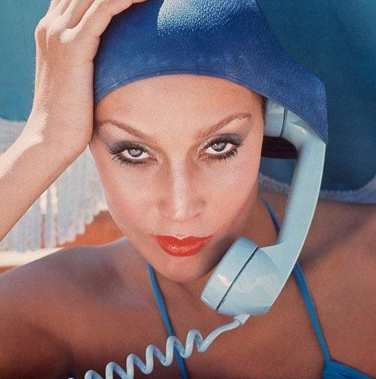 Jerry Hall. American model Jerry Hall poses with a telephone in Jamaica for British Vogue, 1975.