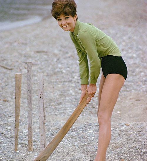 Audrey Hepburn plays cricket on the beach