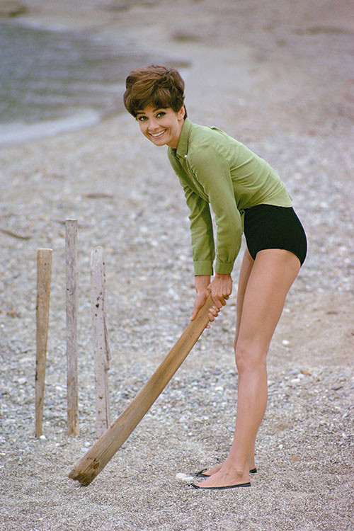 Audrey Hepburn plays cricket on the beach