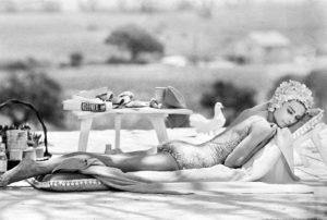 Actress Audrey Hepburn relaxing by a pool